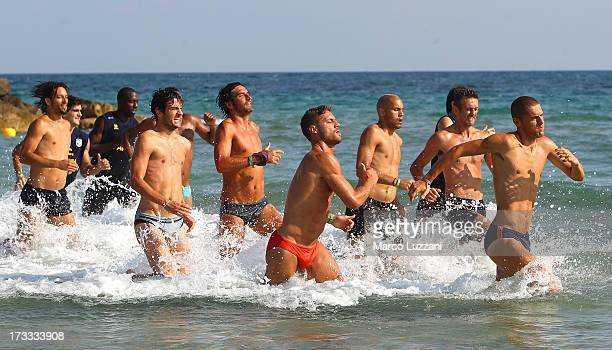 Parma FC players run in the sea during a Parma FC PreSeason Training Session at Rosa Marina Resort on July 12 2013 in Ostuni Italy