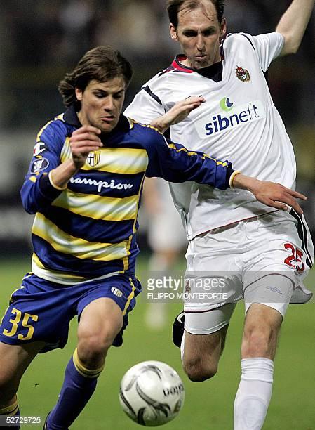 Parma FC's Daniele Dessena vies with Elvir Rahimic of CSKA Moskva during their Uefa Cup semi-final first leg football match in Parma's Tardini...