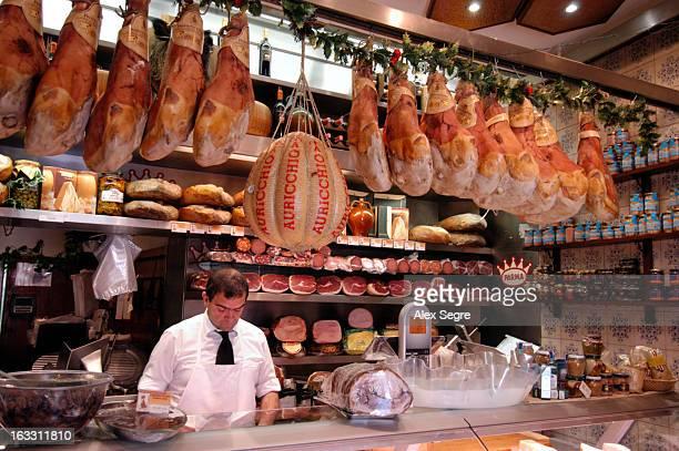 Parma hams in a deli food store