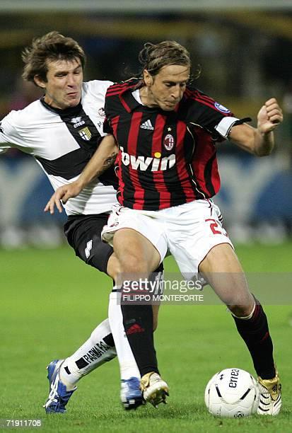 Milan Massimo Amborsini Vitali Kutuzov fights for the ball with Domenico Morfeo of Parma during Serie A football match, 17 September 2006 at Parma's...