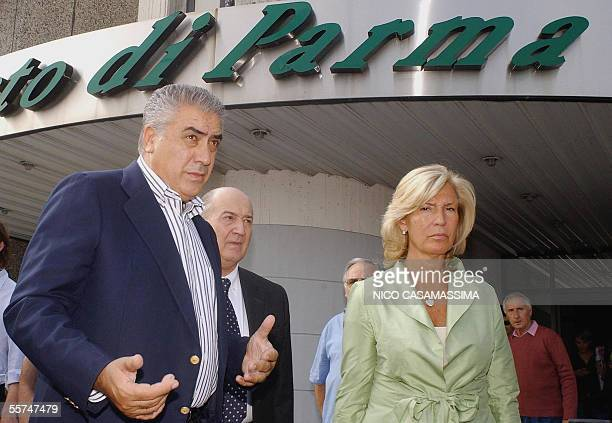 Former Real Madrid president Lorenzo Sanz arrives at the Parma's airport next an unidentified woman23 September 2005 Sanz has moved a step closer to...