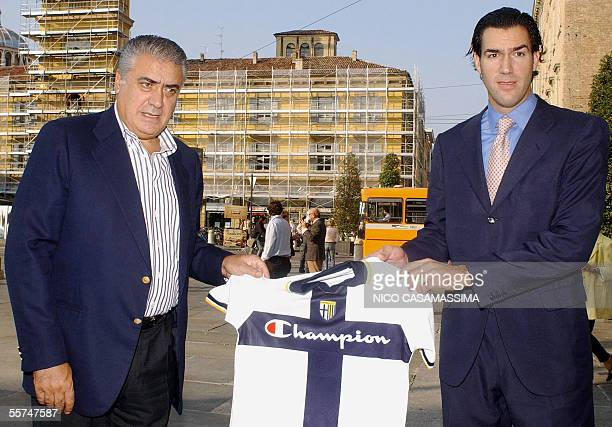 Former Real Madrid president Lorenzo Sanz shows a Parma's jersey as he poses with his son Lorenzo jr 23 September 2005 Sanz has moved a step closer...
