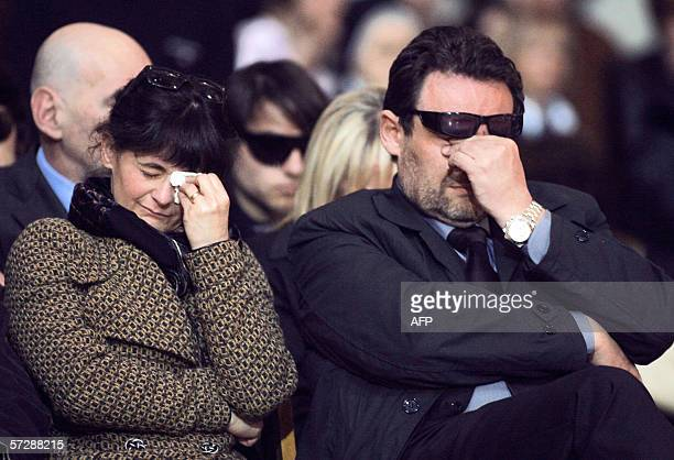 Paolo Onofri and his wife Paola Pellinghelli cry inside Parma's Dome during the funeral of their 17month old son Tommaso 08 April 2006 The boy was...