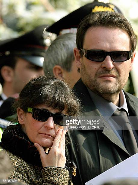 Paolo Onofri and his wife Paola Pellinghelli stand outside Parma's Dome after the funeral of their son 17month old Tommaso 08 April 2006 The little...