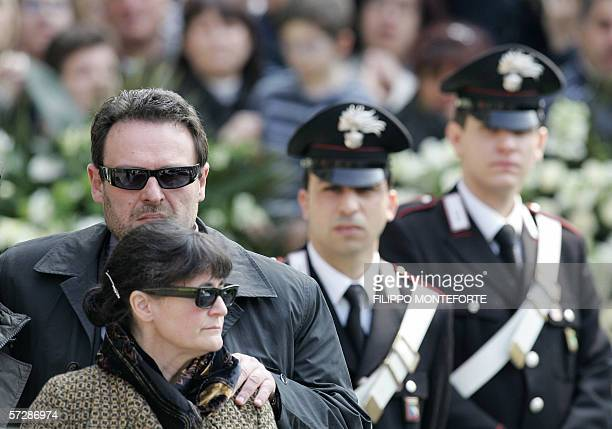 Paolo Onofri conforts his wife Paola Pellinghelli as they arrive at Parma's Dome for the funeral of their son 17month old Tommaso 08 April 2006 The...