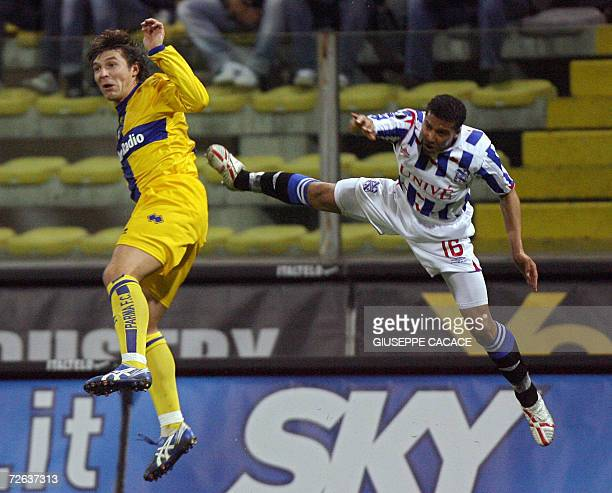 Parma's forward Vitali Kutuzov of Belarus fights for the ball with Heerenveen's Gianni Zuiverloon during their UEFA Group D football match at the...