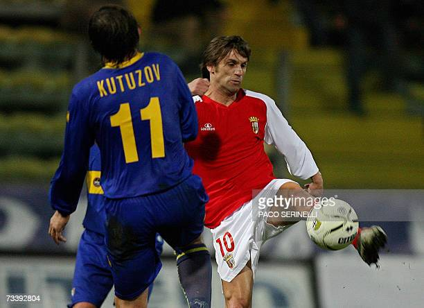 Parma's forward Vitali Kutuzov of Belarus fights for the ball with Braga's forward Joao Pinto during their Uefa Cup football match, second leg, at...