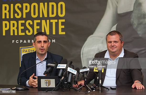 Parma Mayor Federico Pizzarotti and Parma FC President Tommaso Ghirardi speak to the media during a press conference at the club's training ground on...