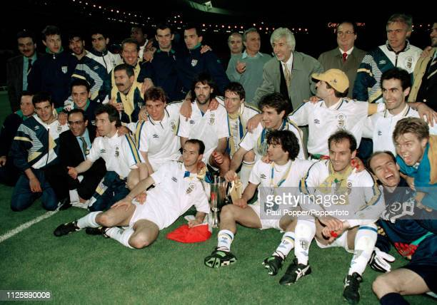 Parma players and staff celebrate with the trophy after the 1993 European Cup Winners Cup Final between Parma and Royal Antwerp at Wembley Stadium on...