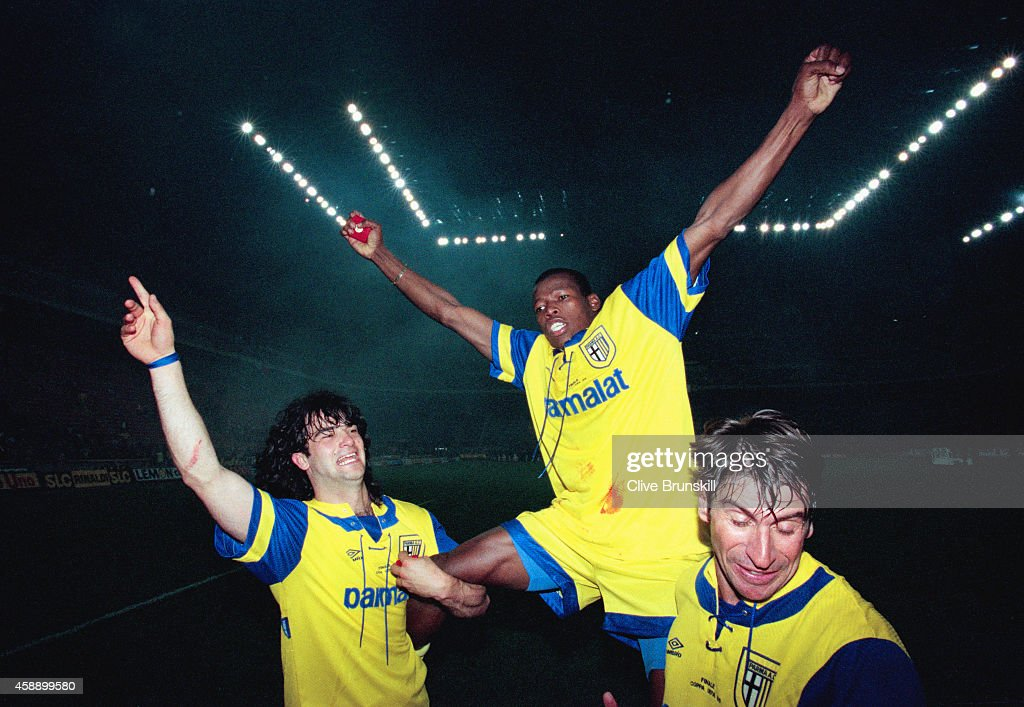 Parma striker Faustino Asprilla (c) is held aloft by team mates Fernando Coulo and Massimo Crippa (r) after the second leg of the 1995 UEFA Cup Final between Parma and Juventus at the San Siro on May 17, 1995 in Milan, Italy.
