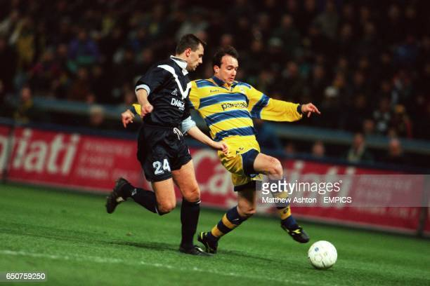 Parma's Abel Balbo stretches for the ball with Bordeaux's Herve Alicarte in close attendance