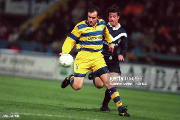 Parma's Abel Balbo tries to get away from Bordeaux's Francois Grenet