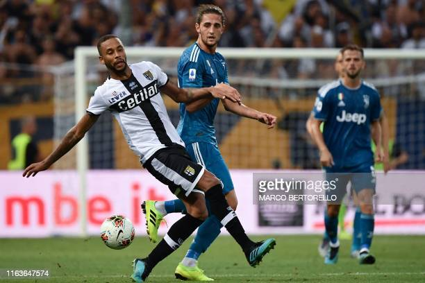 Parma's Brazilian midfielder Hernani and Juventus' French midfielder Adrien Rabiot go for the ball during the Italian Serie A football match Parma vs...