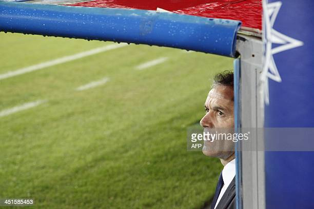 Parma's coach Roberto Donadoni looks on during the Serie A football match SSC Napoli vs Parma FC at San Paolo Stadium in Naples on November 23 2013...