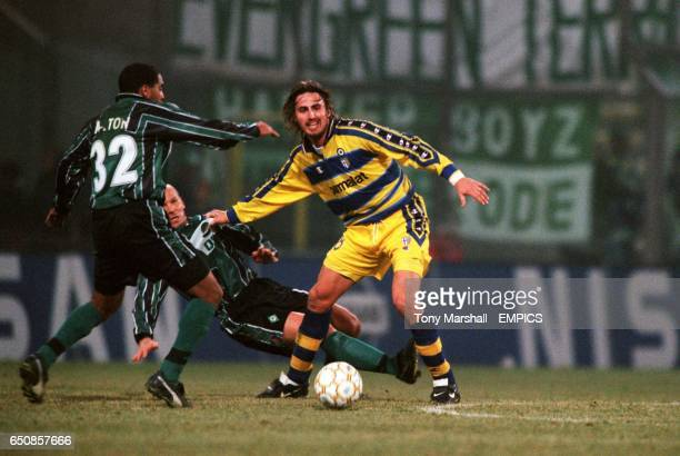 Parma's Dino Baggio is faced with Werder Bremen's Ailton after getting away from Bernhard Trares