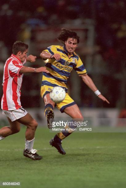 Parma's Dino Baggio steals the ball from Vicenza's Pasquale Luiso