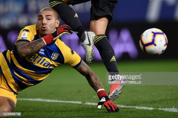 Parma's goalkeeper Luigi Sepe makes a save during the Italian Serie A football match Parma vs Juventus on September 1 2018 at Ennio Tardini stadium...