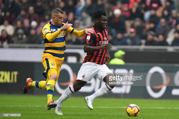 Parma's Italian defender Simone Iacoponi fights for the ball with AC Milan's Ivorian midfielder Franck Kessie during the Italian Serie A football...