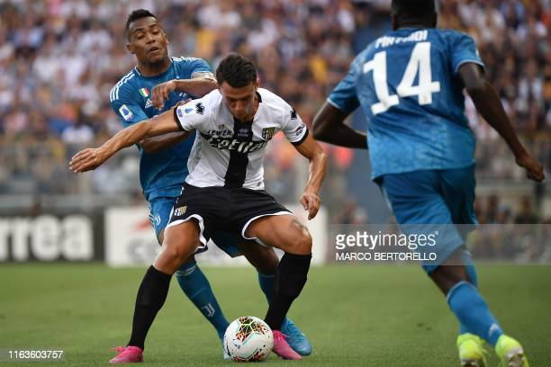 Parma's Italian forward Roberto Inglese holds off Juventus' Brazilian defender Alex Sandro during the Italian Serie A football match Parma vs...