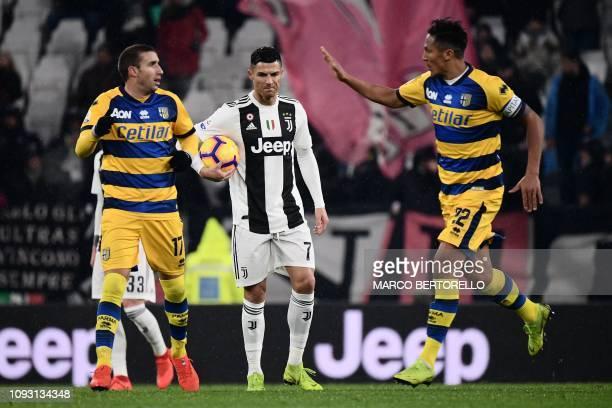 Parma's Italian midfielder Antonino Barilla celebrates with Parma's Portuguese defender Bruno Alves after scoring as Juventus' Portuguese forward...