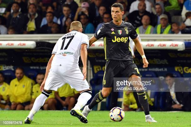 Parma's Italian midfielder Antonino Barilla vies with Juventus' Portuguese forward Cristiano Ronaldo during the Italian Serie A football match Parma...