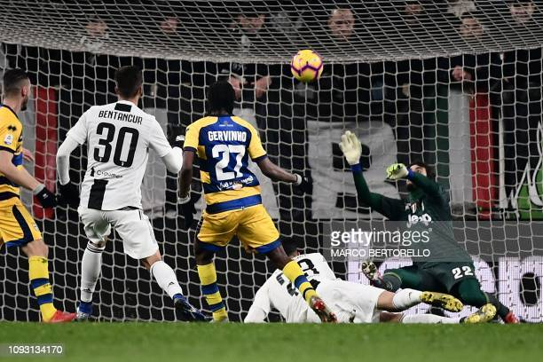 Parma's Ivorian forward Gervinho scores a last second equalizer during the Italian Serie A football match Juventus vs Parma on February 2 2019 at the...