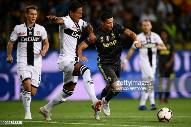 Parma's Portuguese defender Bruno Alves vies with Juventus' Portuguese forward Cristiano Ronaldo during the Italian Serie A football match Parma vs...