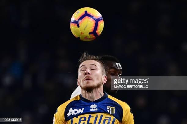 Parma's Slovakian midfielder Juraj Kucka and Juventus' French midfielder Blaise Matuidi go for a header during the Italian Serie A football match...