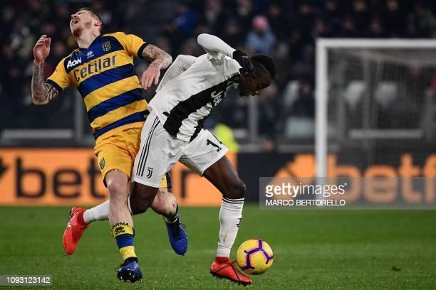 Parma's Slovakian midfielder Juraj Kucka collides with Juventus' French midfielder Blaise Matuidi during the Italian Serie A football match Juventus...