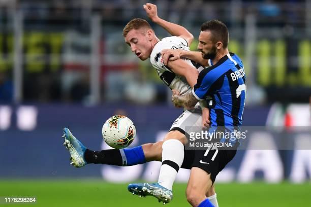 Parma's Swedish midfielder Dejan Kulusevski and Inter Milan's Croatian defender Marcelo Brozovic go for the ball during the Italian Serie A football...