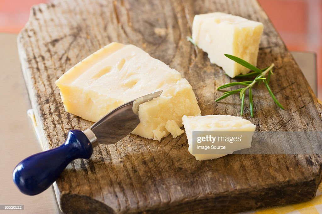 Parmesan and a cheese knife : Stock Photo