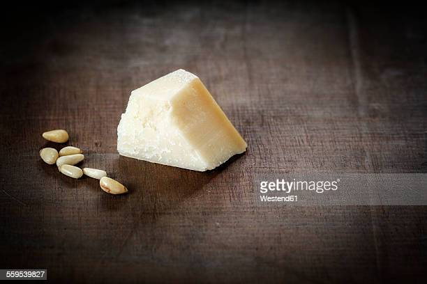 Parmesan and pine nuts on wood