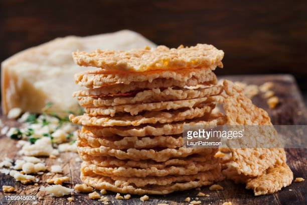 parmesan cheese crisps - cracker snack stock pictures, royalty-free photos & images