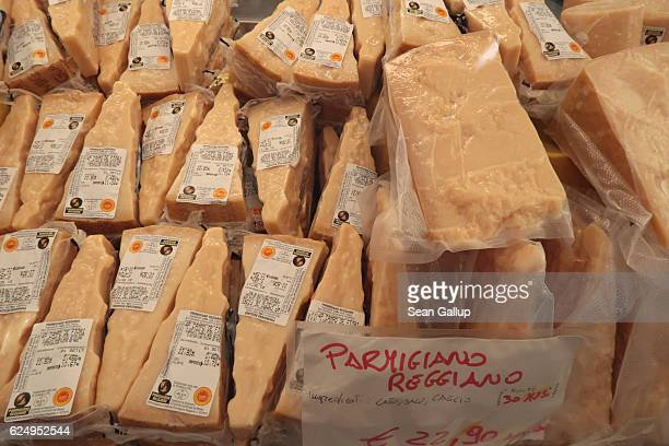 Parmesan cheese lies on display for sale at an outdoor market on October 29 2016 in Rome Italy Rome is among Europe's major tourist destinations