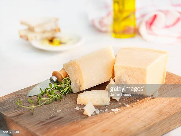 Parmesan cheese on chopping board