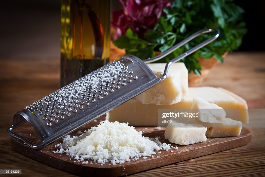 Parmesan cheese with grater : Stockfoto