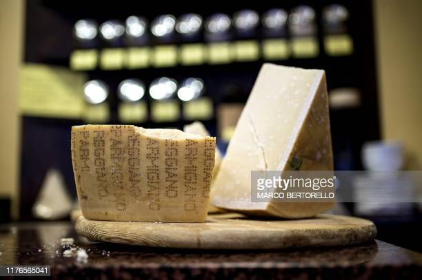 Parmigiano Reggiano Parmesan cheese is pictured on October 18 2019 in a cheese shop in Saluzzo near Turin With Washington starting to apply swingeing...