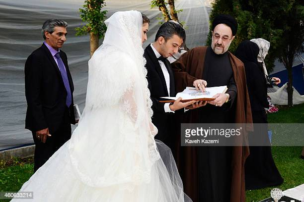 Parmis Taheri and Mostafa Aghaei seen with ex president Khatami after their wedding sermons at the social club of Mining Industry Bank on May 1 2014...