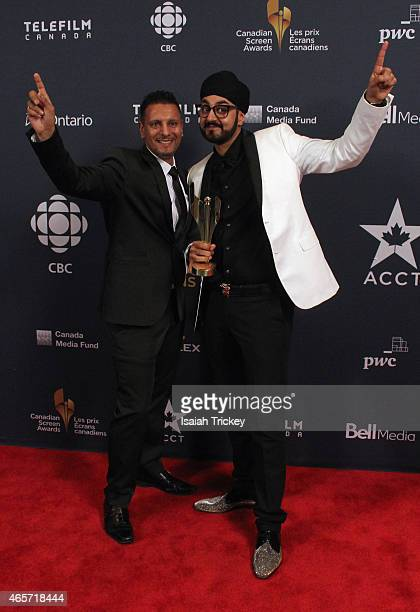 Parmjit Sarai and Manjeet Ral pose in the press room at the 2015 Canadian Screen Awards at the Four Seasons Centre for the Performing Arts on March 1...