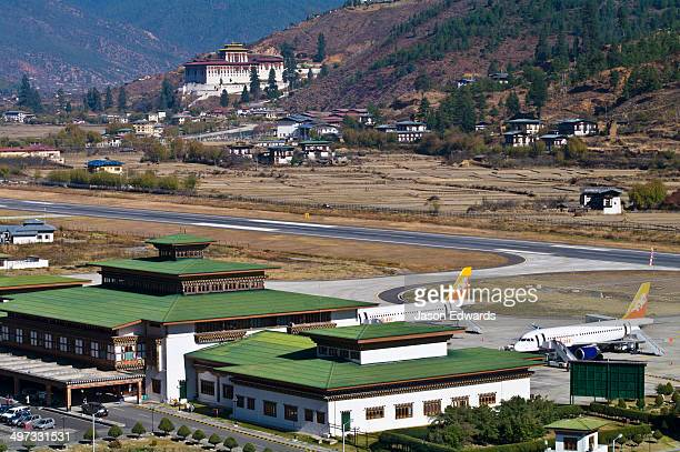 Paro International Airport terminal and tarmac is overlooked by Paro Dzong.