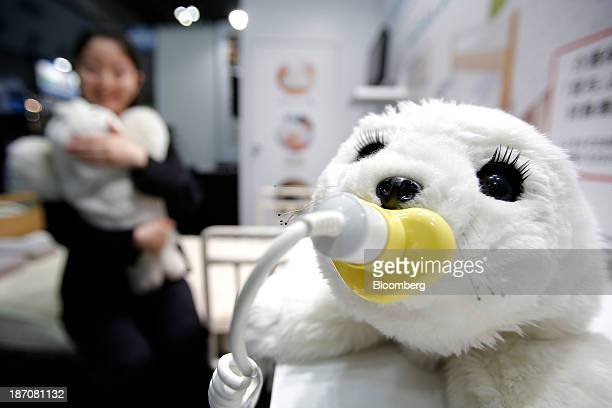A Paro sealtype therapeutic robot developed by the National Institute of Advanced Industrial Science and Technology sits on display while an...