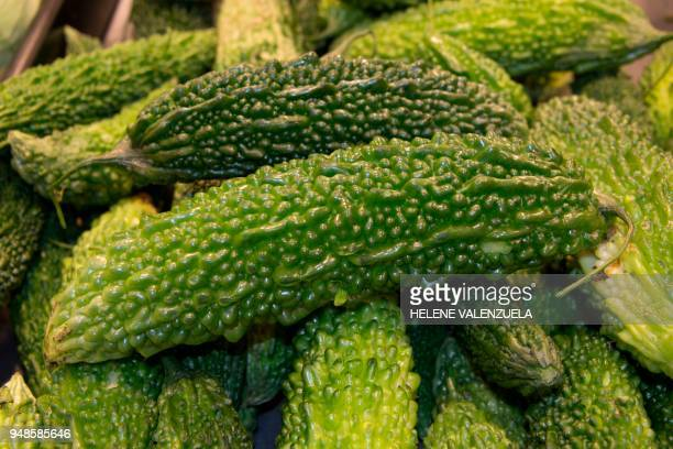 Paroka fruits are pictured at the fruit and vegetable department of an 'O Marche' supermarket in SaintFrancois on the French overseas territory of...