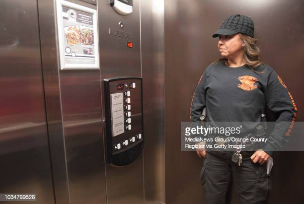 Parole agent Jessica Latumeten rides the elevator in an Anaheim apartment complex to do a compliance check on a parole sex offender as part of a...