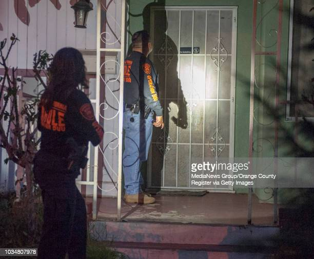 Parole agents Jessica Latumeten left and George Meza knock on the door of an Anaheim home as part of Operation Boo a California Department of...