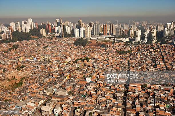 parque real, favela or slum living next to upscale morumbi neighborhood in sao paulo, brazil - imbalance stock pictures, royalty-free photos & images