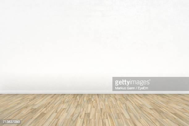 Parquet Floor Against White Wall In Empty Room