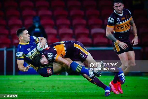 Parramatta Eels' player Ryan Matterson is tackled by Brisbane Broncos' player Corey Oates during the Australian Rugby League match between the...