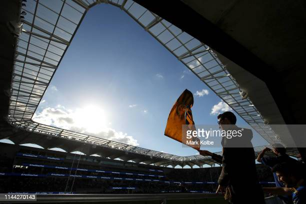 Parramatta Eels supporter waves a flag as he watches the warm-up before the round 6 NRL match between the Parramatta Eels and Wests Tigers at...