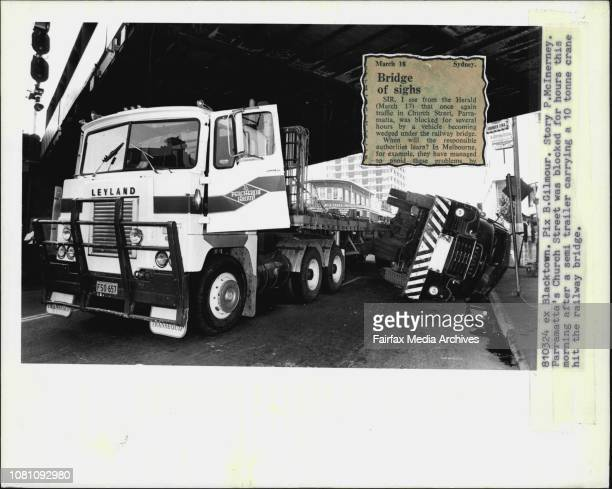 Parramatta's Church Street was blocked for hours this morning after a semi trailer carrying a 10 tonne crane hit the railway bridge March 24 1981