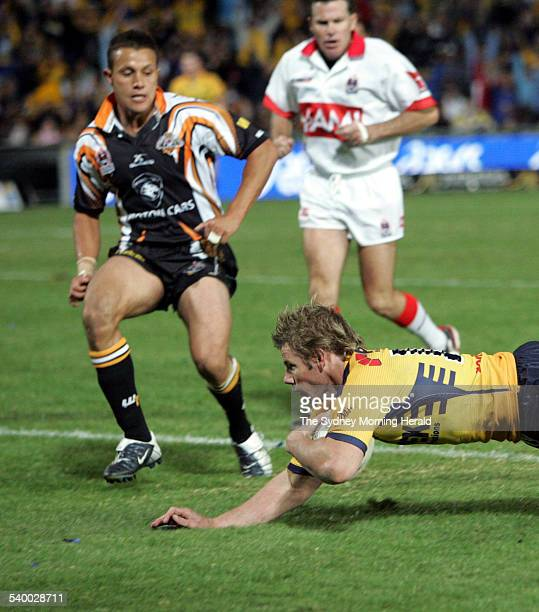 Parramatta's Glenn Morrison scores a try during the NRL Round 7 match between the Parramatta Eels and Wests Tigers at Parramatta Stadium 21 April...